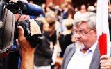 academic-activist-tv-camera-interview