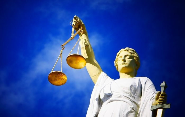 scales-of-justice-statue-standing-for-human-rights