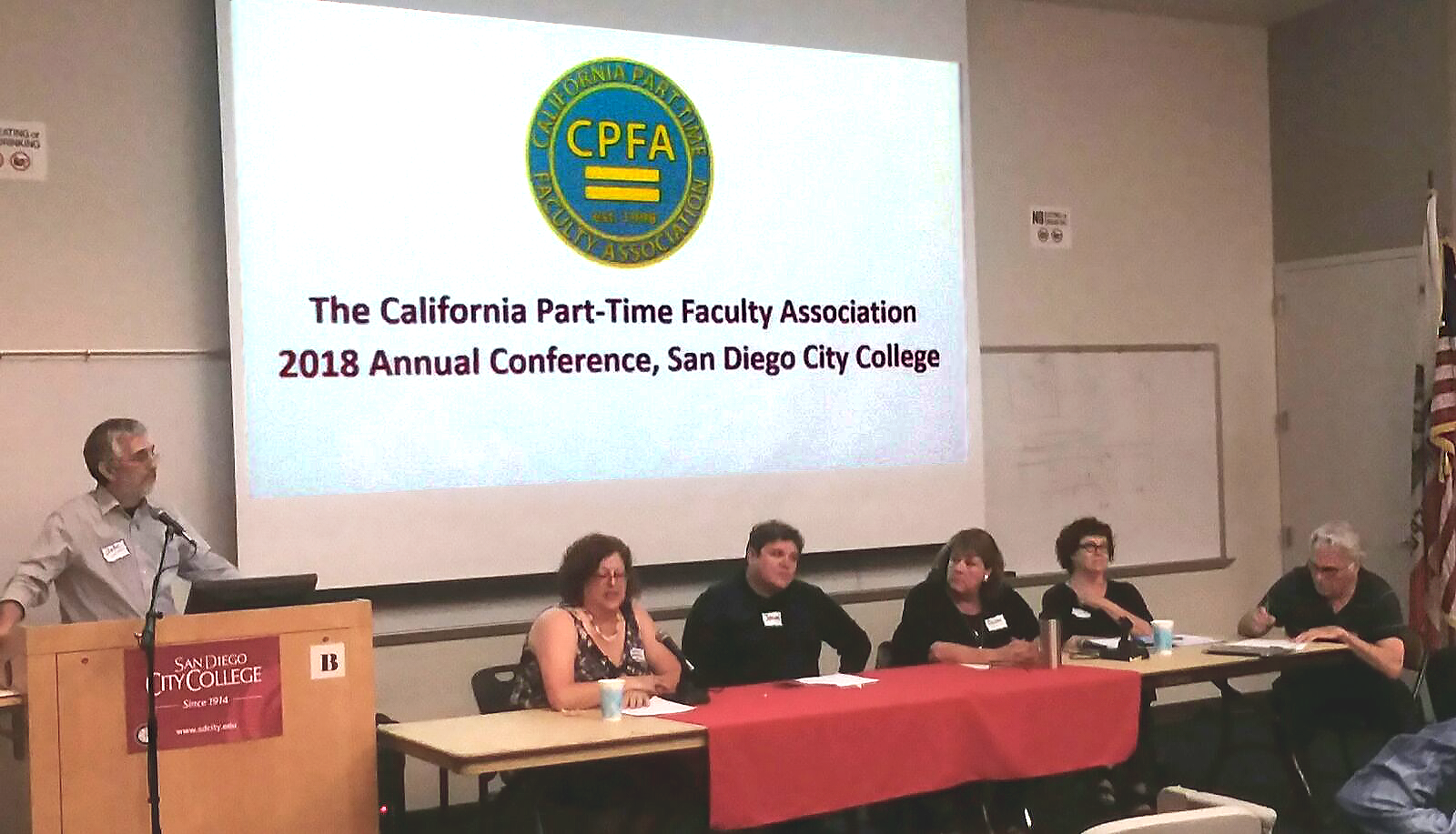 John-Martin-at-podium-introducing-speakers-and-panel-discussion-CPFA-Conference