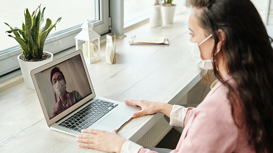 woman-having-a-video-call-wearing-face-mask